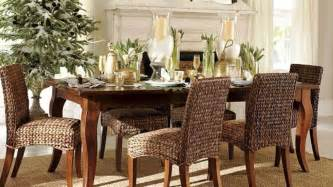 dark brown wicker dining set with chairs having white