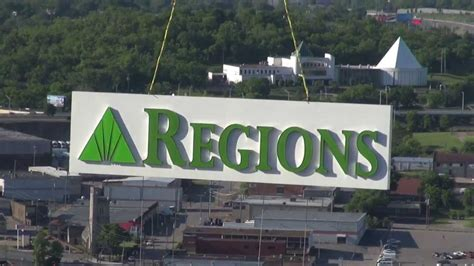 regions bank tn helicopter sign installation for regions bank in nashville