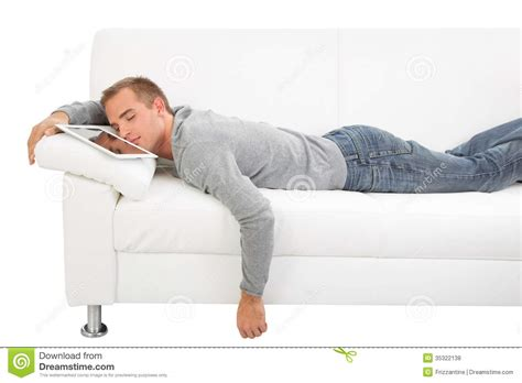 a man and a couch man sleep with tablet pc stock photo image of