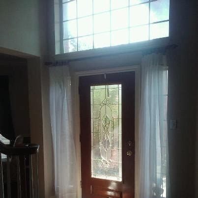 curtain over front door curtain rod over front door house pinterest