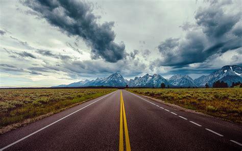 wallpaper 4k road straight road horizon mountains wallpaper