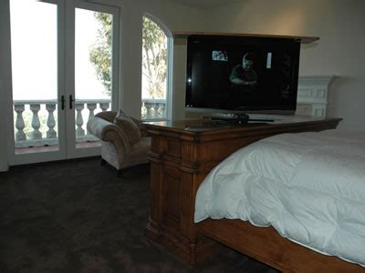 tv rises and pivots out of custom greenwich bed set