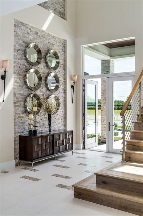 double height stair wall design entry transitional