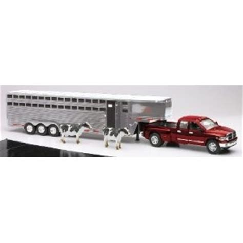dodge ram pickup truck with fifth wheel trailer and cows