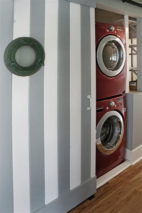 concealed washer dryer stack flickr photo sharing stacked washer and dryer behind sliding door