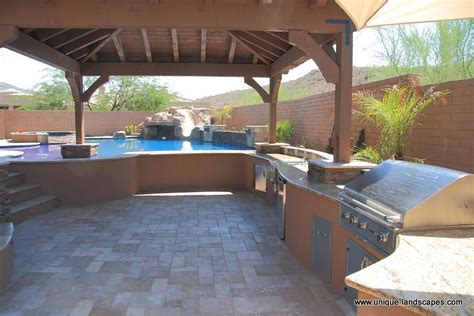 outdoor pool and patio daytime view steps lead to the pool open area for a