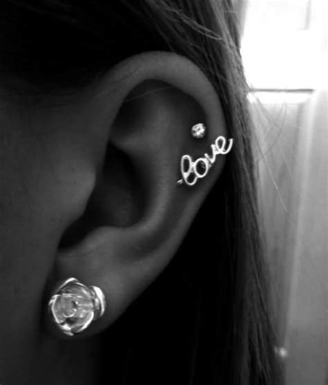 tattoo parlor ear piercing near me white rose stud lobe and cartilage tattoo with love stud