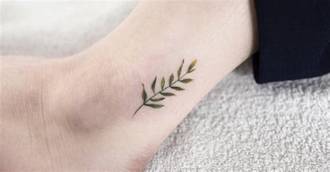 minimalist leaf tattoo minimalist leaf tattoo on the ankle