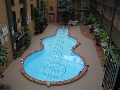 guitar shaped swimming pool the world s coolest guitar shaped pool is right here in