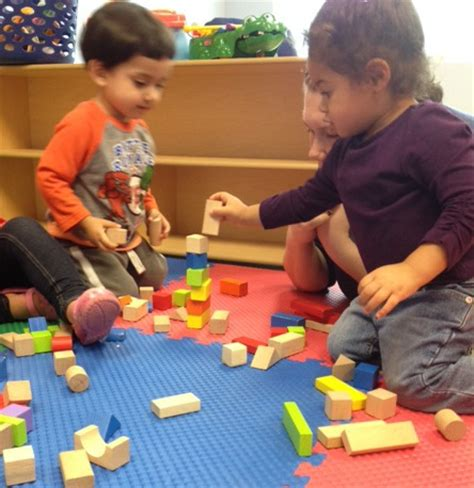 teaching new year to kindergarten practicing stacking blocks in the one year classroom