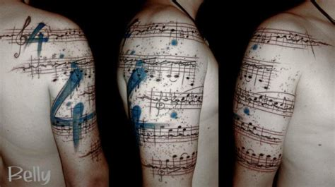 sheet music tattoo shoulder arm by belly button