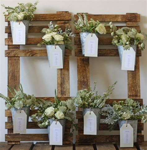 rustic themed wedding seating plan ur rustic wedding table plan with flower pots 2161354