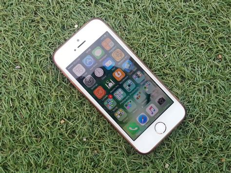 on iphone photos silver iphone on a green grass 183 free stock photo