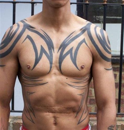 tribal tattoo on shoulder belly and chest
