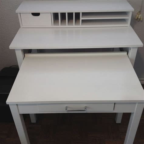 container store white roll out desk and a modern white