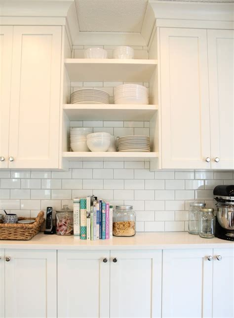 cloud white kitchen cabinets cloud white cabinets light gray grout white subway tiles