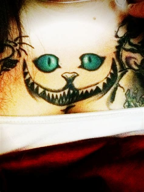 cat tattoo tim burton cheshire cat from tim burton s alice in wonderland tattoo