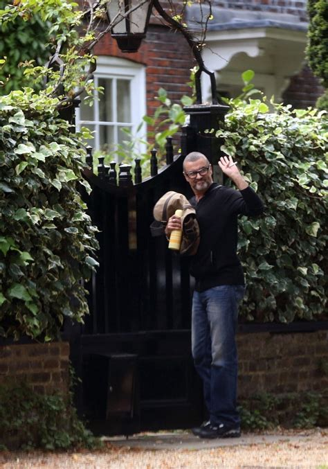 george michael home george michael photos photos george michael arrives home