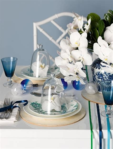blue christmas table setting with flower ornaments