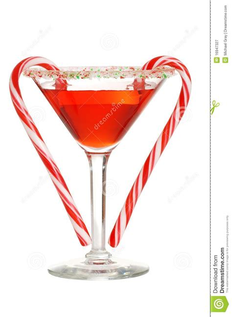 martini red red martini with two candy canes royalty free stock