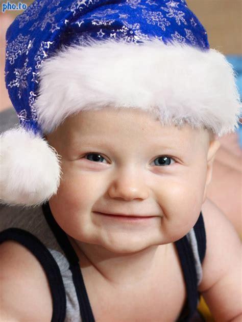 put blue santa hat on photo online using santa hat editor