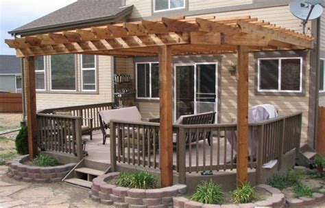 love the idea of a pergola over the deck with flower boxes