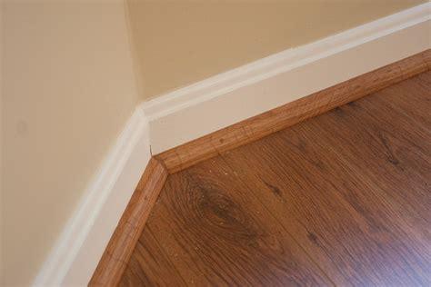 Laminate Floor Vs Hardwood quarter round eric mesa flickr