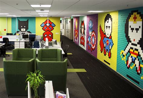 Marvel Wall Murals office workers install 8 bit superhero mural using 8 024