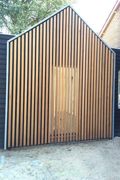 lamellen hout verticaal aanbouw woonhuis blaricum bijna afgerond boks architectuur