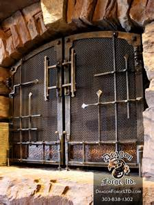 rustic fireplace doors gnl entertaining room copper and steel fireplace doors