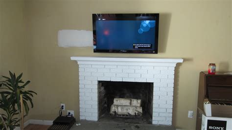 mounted tv fireplace richey llc audio experts tv installation home theater whole home audio smart