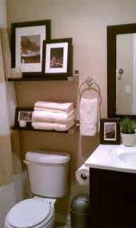 How To Decorate Your Bathroom by Small Bathroom Decorative Storage Above Toulet Bathroom
