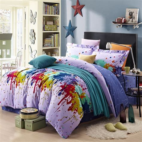 paint splatter comforter navy blue red and yellow bright colorful paint splatter
