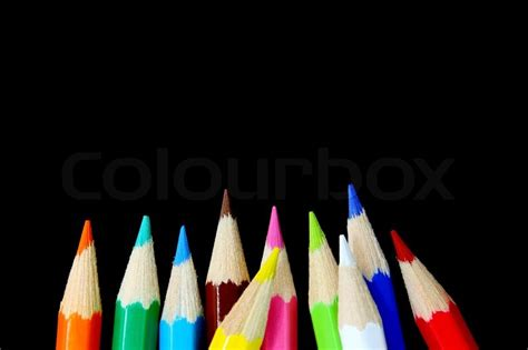 colourful pencils isolated  black background stock