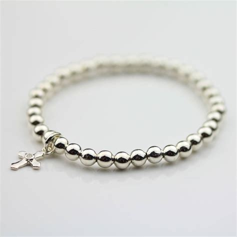 childrens silver christening bracelet with silver cross by