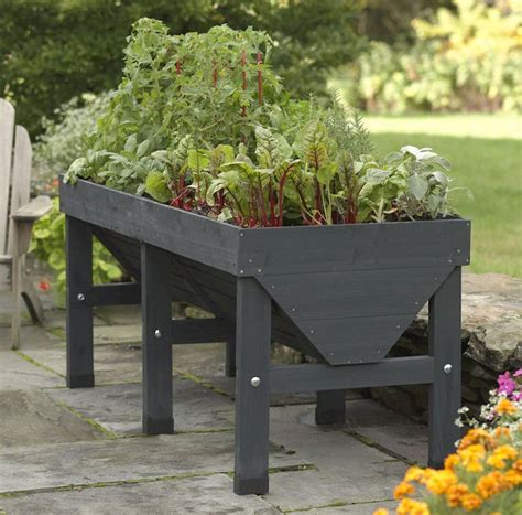 Elevated Garden Planters by 10 Easy Pieces Wooden Elevated Planters Gardenista