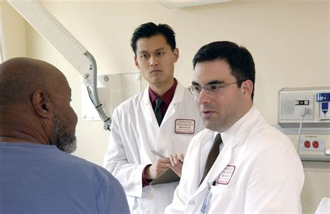 doctor and file doctor consults with patient 4 jpg wikimedia commons