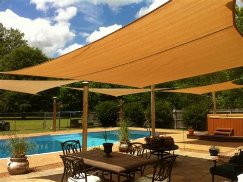 installing outdoor sun shade sails a pool