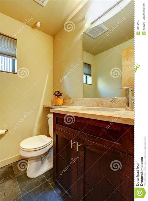 small yellow bathroom small yellow bathroom with wood stock image image 23924559