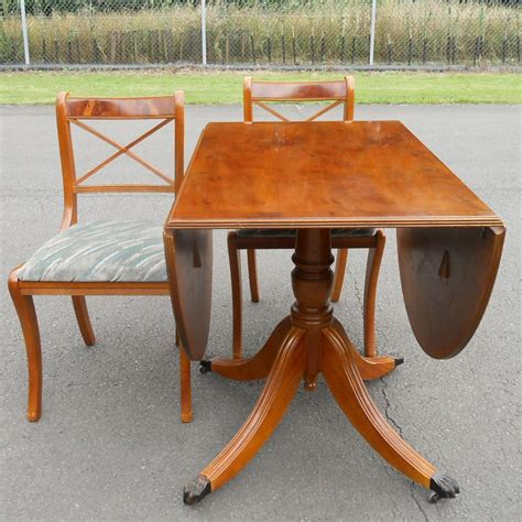 Yew Dining Table Sold Yew Oval Dropleaf Dining Table
