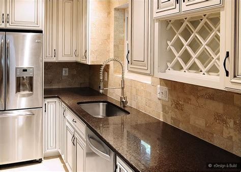 kitchen backsplash ideas with cream cabinets cream cabinets with back splashes brown countertop cream