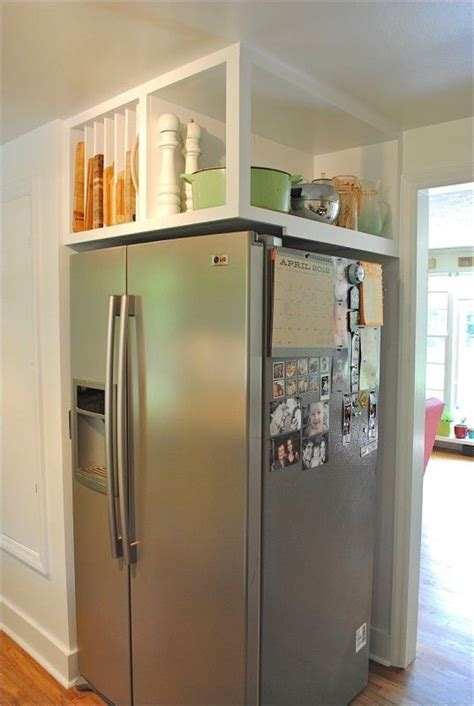 above kitchen cabinet storage ideas above fridge storage organized cabinets cookie sheets and my refrigerator