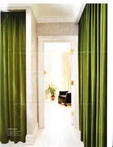 Green Velvet Drapes Green Velvet Drapes Line A Hall In Elliott Puckette S