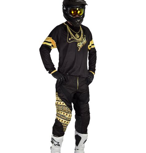 motocross gear gold gold chains on black mx set strikt gear company