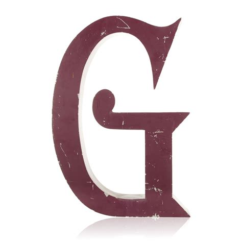 tattoo fonts with color large purple letter g in a blackmoor font caps