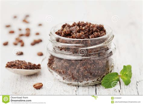 Glass Scrub scrub of ground coffee sugar and coconut in
