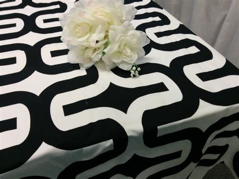 black and white tablecloth create sophisticated drama with a black tablecloth