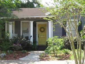 gray house yellow door exterior