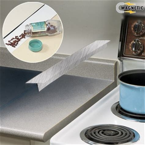 how much space between stove and oven spill guard aluminum slips in space between