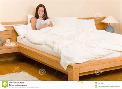 book bed bedroom young woman read book in bed stock image image